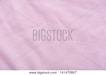 Close up of pink color cotton fabric texture background