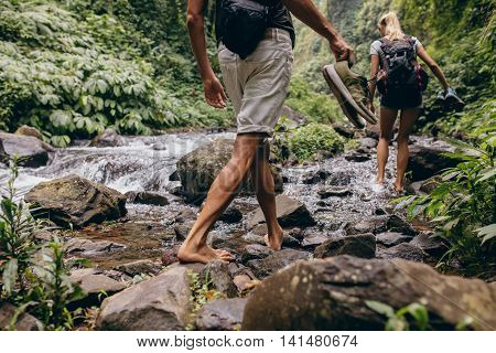 Couple Crossing The Stream Barefooted