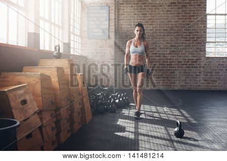 Young Woman Warming Up Before A Intense Workout