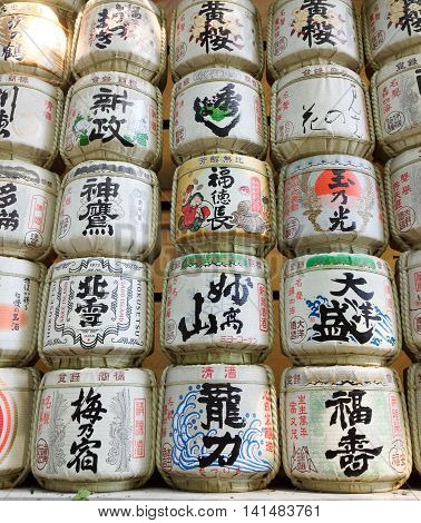 .TOKYO, JAPAN, OCTOBER 8, 2015: rows of colorful Sake barrels stacked high, early afternoon