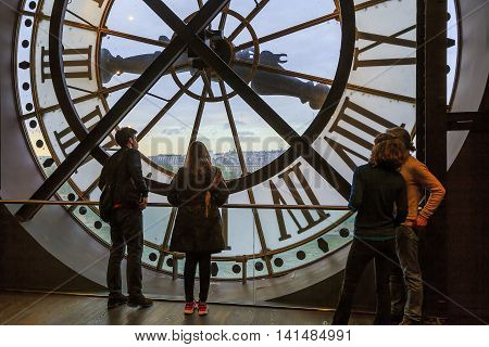 PARIS, FRANCE - MAY 14, 2015: This is window with a clock on the top floor of the Orsay Museum.