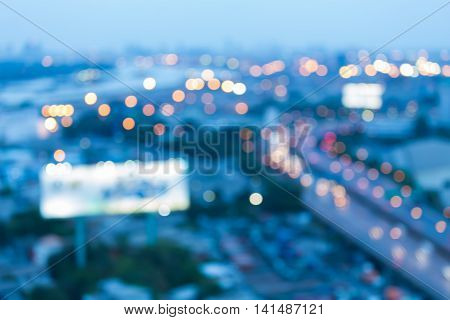 Abstract blurred light night view, city road and highway during busy hours