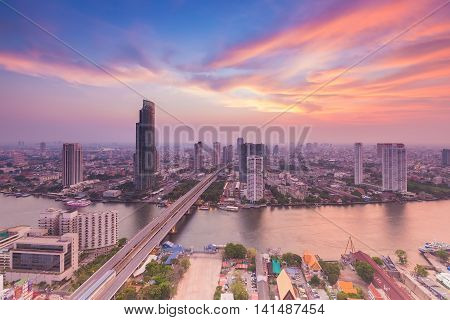 Aerial view of city landscape over river cured and beautiful sky after sunset background