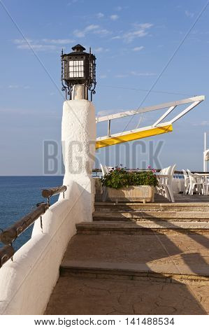 Terrace of a restaurant bar in front the mediterranean sea in Roc de Sant Gaieta Roda de Bera Tarragona Spain.