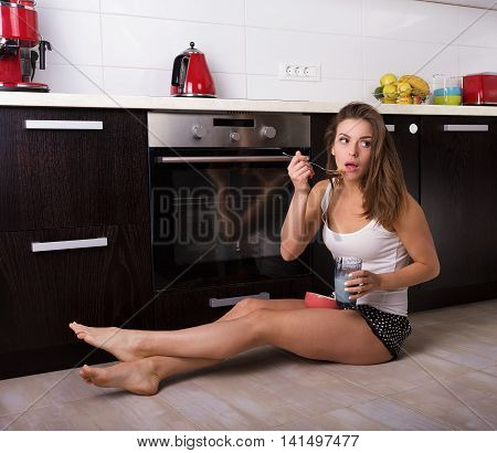 Woman Having A Breakfast At Her Kitchen