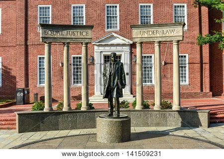 Annapolis, Maryland - June 26, 2016: Thurgood Marshall Monument beside the Maryland State Capital building in Annapolis Maryland on summer afternoon. It is the oldest state capitol in continuous legislative use dating to 1772.