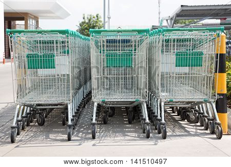 Row of shopping carts on a parking lot