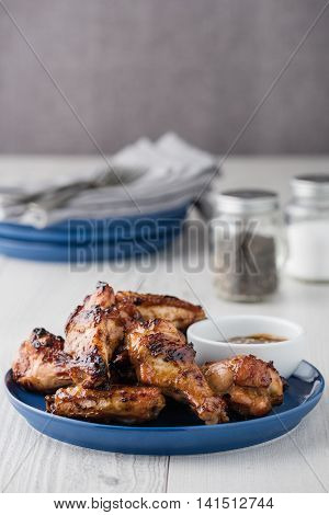 Teriyaki Chicken Wings With Sauce On White Table Top