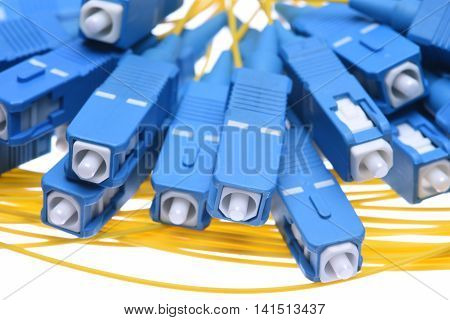 Fiber cables sc connectors closeup isolated on white background