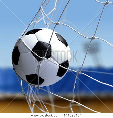 soccer ball is in goal net during a match