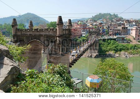 MANDI, INDIA - MAY 12, 2011: View on the old suspension bridge Victoria in the city of Mandi. Historical landmark of the Himachal Pradesh, India