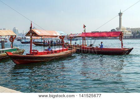 DUBAI UAE - JANUARY 23: Boats Abra ferries on the Bay Creek in Dubaii UAE circa January 2016