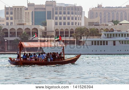 DUBAI UAE - JANUARY 23: Tourist Boats Abra ferries on the Bay Creek in Dubaii UAE circa January 2016