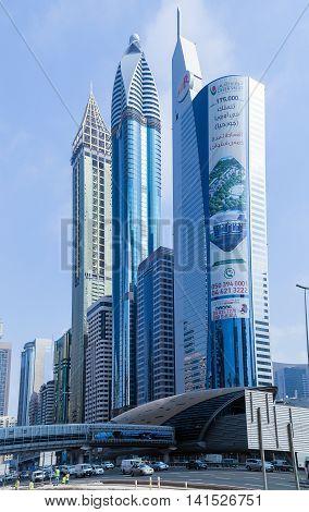 DUBAI UAE - JANUARY 26: Street architecture of Dubai's many highrise buildings. Dubai with many traditional arabic shops and biggest street market. Dubai UAE circa January 2016