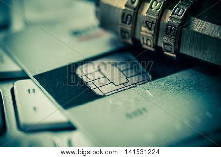 Security lock on credit cards with computer keyboard / Credit card data encryption concept