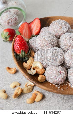 Homemade strawberry date cashew and coconut bliss ball