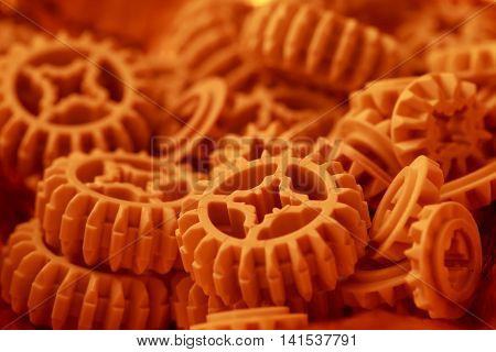 Plastic orange gears texture for your background