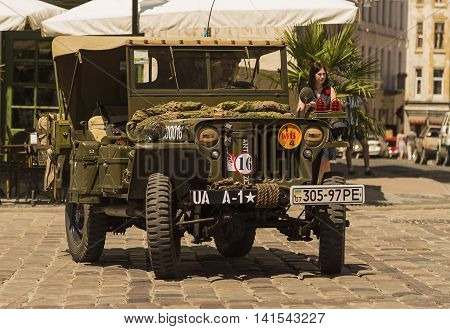 Lviv Ukraine -- June 12 2015: The restored car JEEP WILLYS (Military Police) is demonstrated by Leopolis Grand Com at Market Square in Lviv Ukraine
