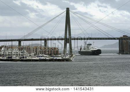 Car passenger ferry under harbour suspension bridge entering Stavanger Harbour, Stavanger, Rogaland, Norway