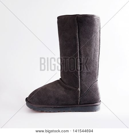 grey female winter boots over white background