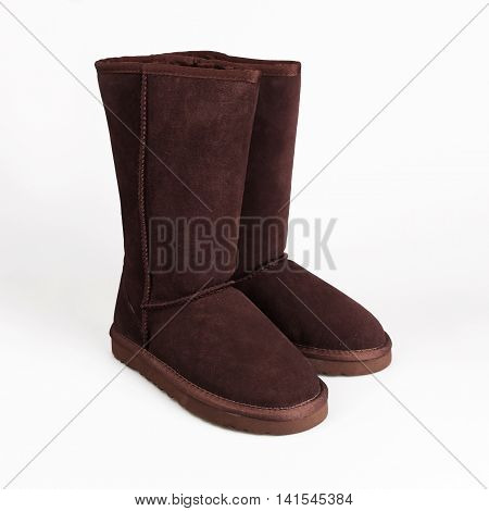female brown winter shoes over white background