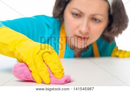 Woman Meticulously Rubbing The White Table A Rag, Hand Closeup