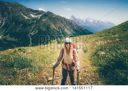 Woman hiker with backpack mountaineering Travel Lifestyle concept active vacations outdoor mountains on background summer adventure