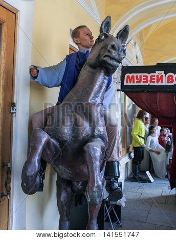 St. Petersburg, Russia - 9 April, Figure Putin on horseback, 9 April, 2016. Wax Museum Gallery large Gostiny Dvor.