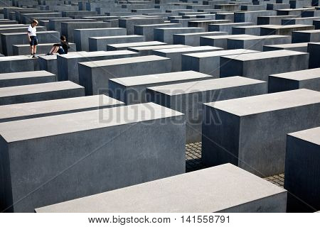 Berlin, Germany - July 1, 2016: The Memorial to the Murdered Jews of Europe in the centre of Berlin is the German Holocaust Memorial honouring and remembering the up to six million Jewish victims of the Holocaust.Is located in central Berlin near the Bran