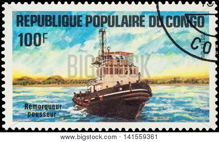 MOSCOW RUSSIA - AUGUST 05 2016: A stamp printed in Congo shows image of pusher tug series