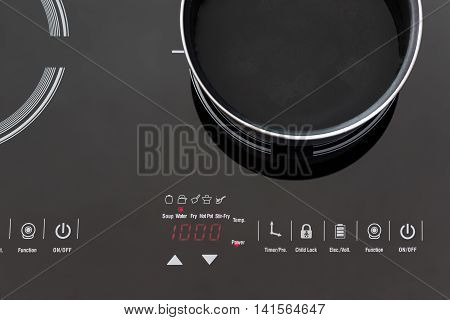 Boiling Water At Pan On Induction Stove Top Panel