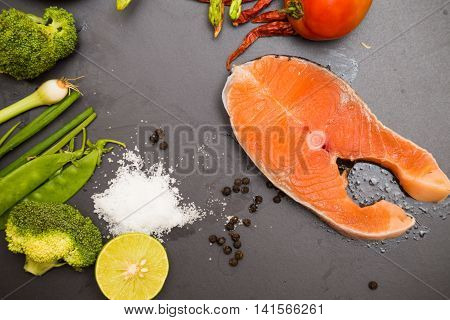 Fresh Raw Norway Salmon Fillet With Green Vegetable Spicy Herb Olive Oil And Lime