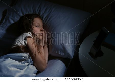 Cute sleeping girl in bed