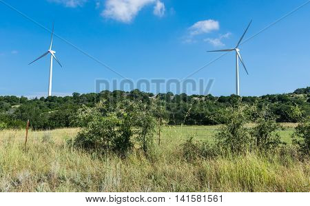 Wind Turbine Farm in West texas on a Dry summer day in the central Texas Hill country near goldthwaite , Texas