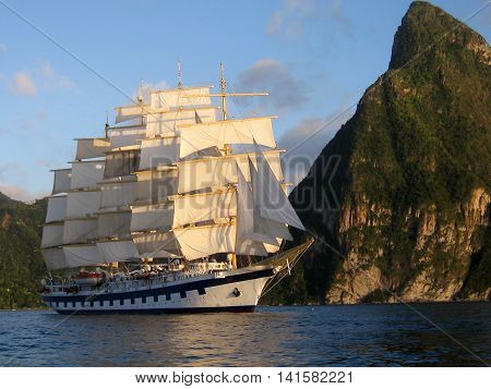 Clipper ship sailing with full sail beneath the Pitons St Lucia