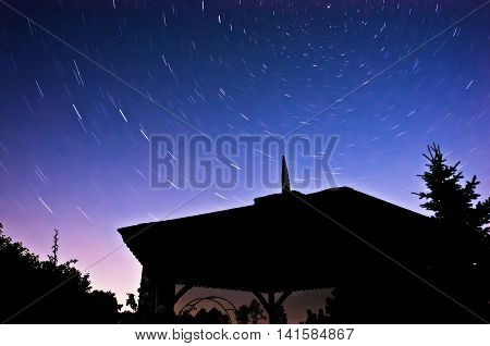 Northern sky at night. Stars movement around the Polar Star long exposure