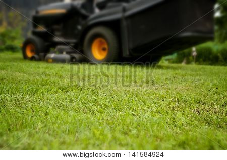 Mowing grass background mower tractor low depth of focus