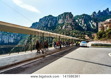 Montserrat Spain - April 6 2016: People on the main entrance to the Santa Maria de Montserrat is a Benedictine abbey located on the mountain of Montserrat nearby from Barcelona
