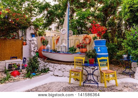 Kos island, Greece - May 14, 2016: Traditional Greek tavern in the town of Kos in May 14, 2016, Kos island, Dodecanese, Greece.