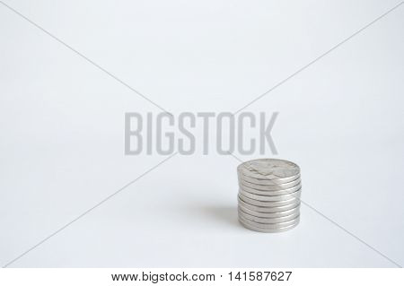 Single stack of U.S. nickels lower right hand.