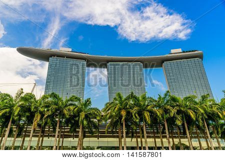SINGAPORE - JULY 10 : Marina Bay sand Hotel on blue sky which is one of Singapore cityscape Modern building at Marina Bay on July 10 2016 in Singapore.