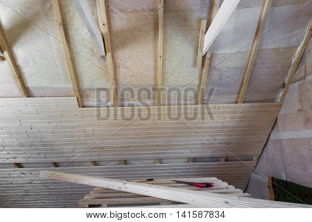 Heat Insulation And Wooden Logs Lathing Ready For Finishing Made Of Tongue And Groove Planks. An Int