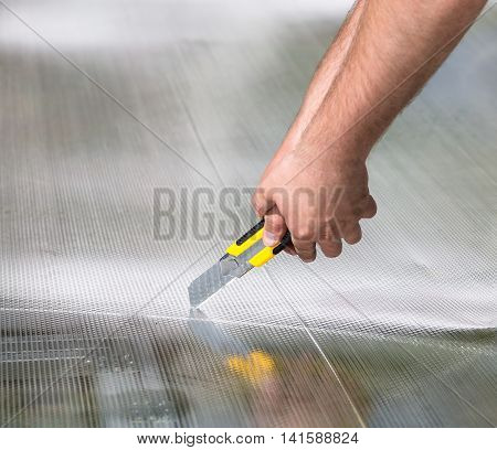 Worker Cutting Polycarbonate With Knife