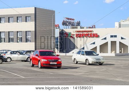 Car parking in front of the hypermarket