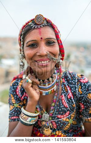 Jaisalmer, India - March 11, 2016: Unidentified gipsy woman in traditional clothes and jewelry on the street of Jaisalmer, Rajasthan, India