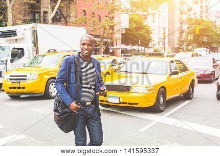 Black Man Crossing A Street In New York.