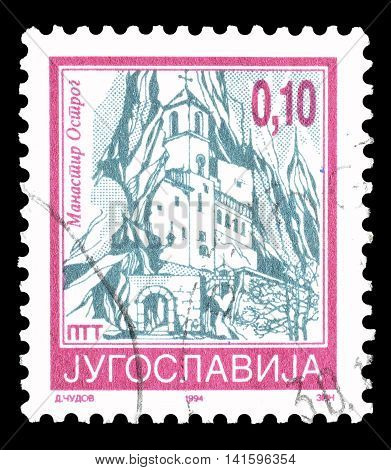YUGOSLAVIA - CIRCA 1994 : Cancelled postage stamp printed by Yugoslavia, that shows Monastery Ostrog.