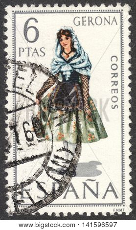 MOSCOW RUSSIA - CIRCA APRIL 2016: a post stamp printed in SPAIN shows a girl in costume of Gerona the series