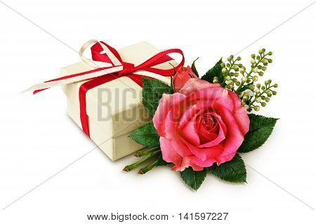 Pink rose flower arangement and a gift on white background