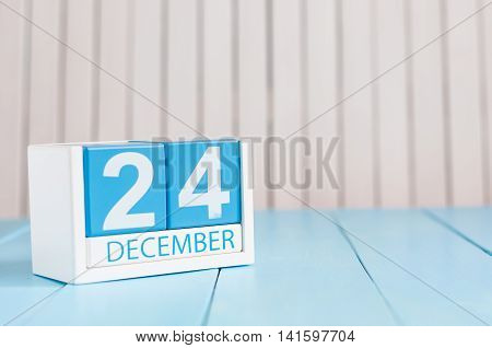 December 24th Eve Christmas. Day 24 of month, calendar on wooden background. New year concept. Empty space for text.